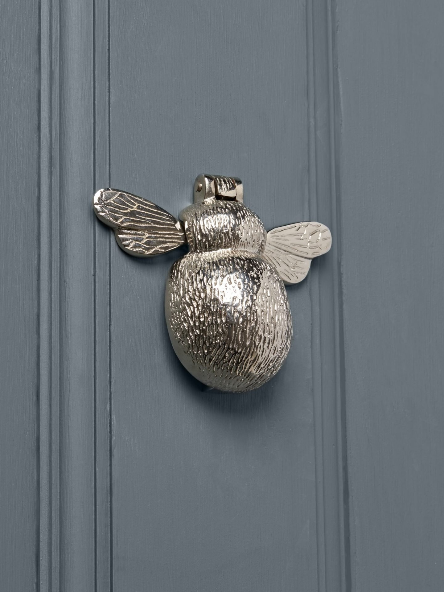 Nickel bee door knocker by Cox and Cox.