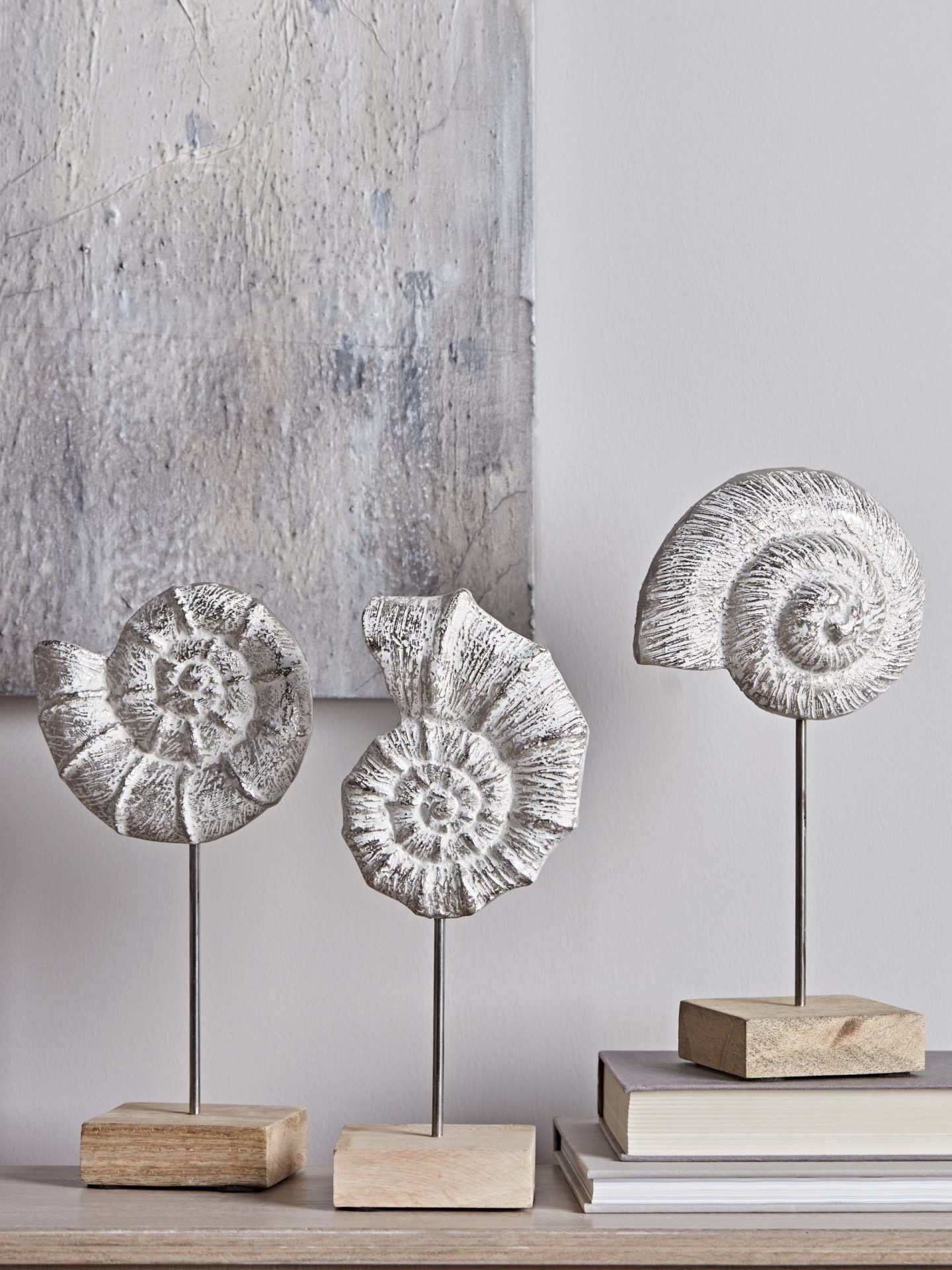Three standing ammonite ornaments by Cox and Cox.