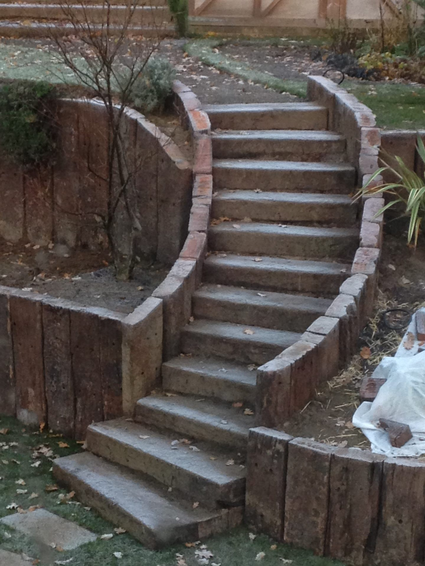 A sweeping garden staircase made of railway sleepers