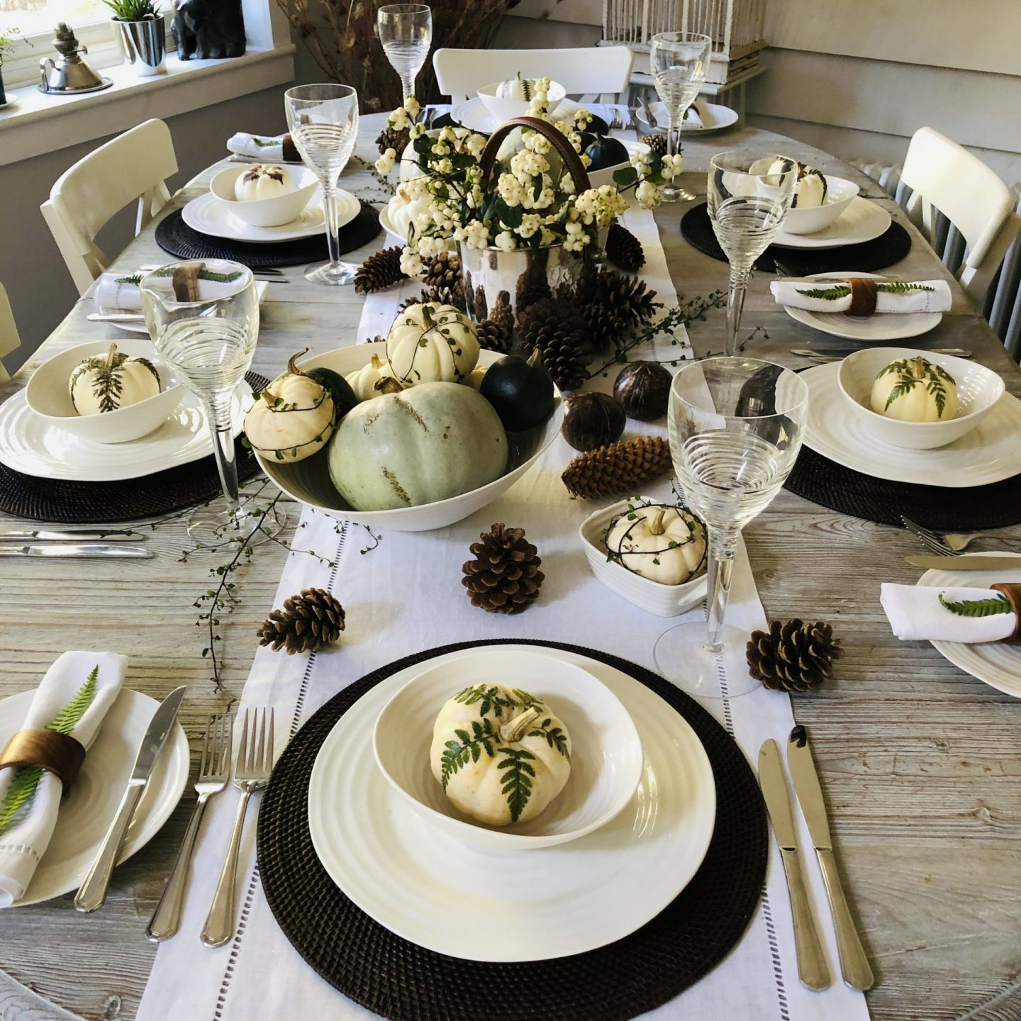 Autumn table styling using white pumpkins.