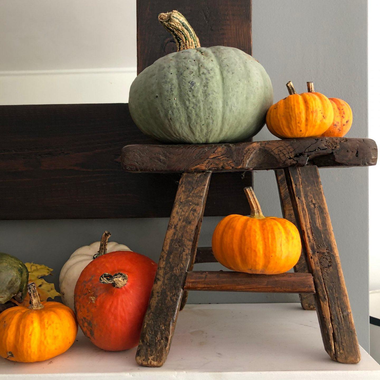 Pumpkins on a wooden stool