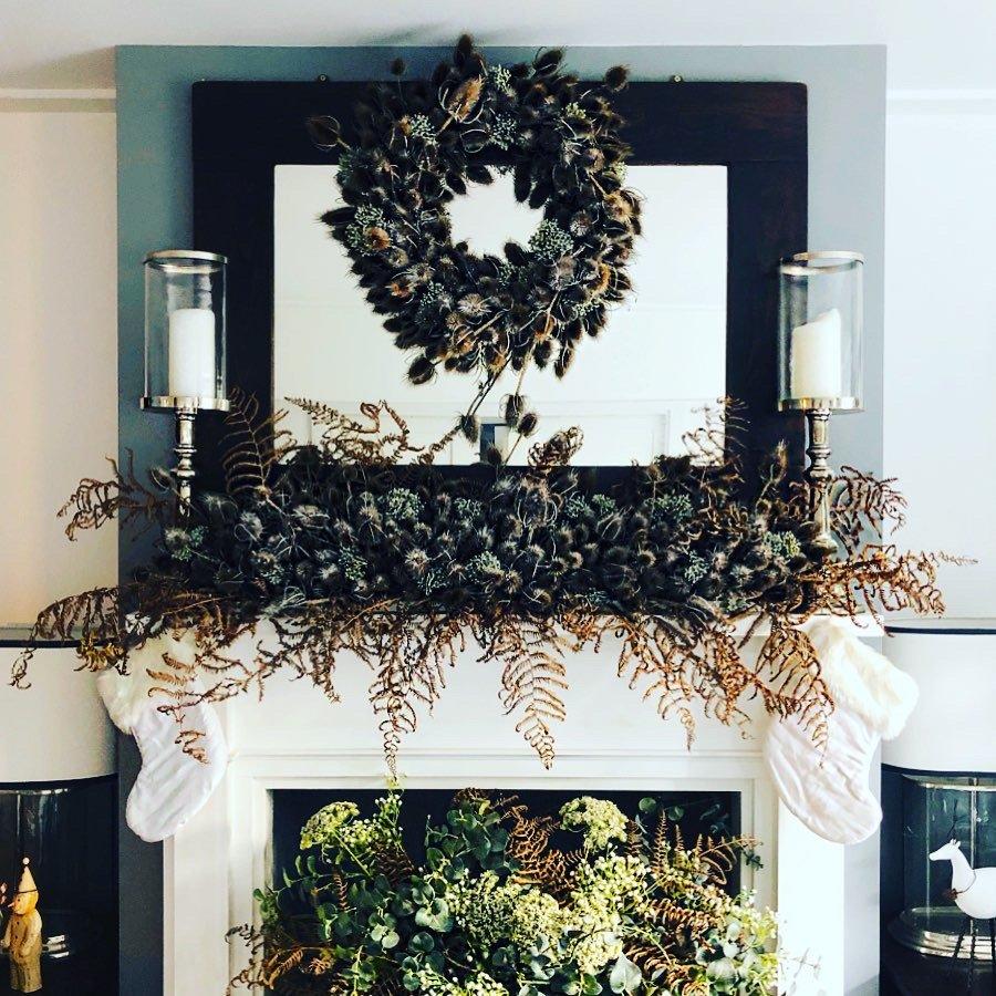 Teasel wreath above a mantle lie etc for christmas