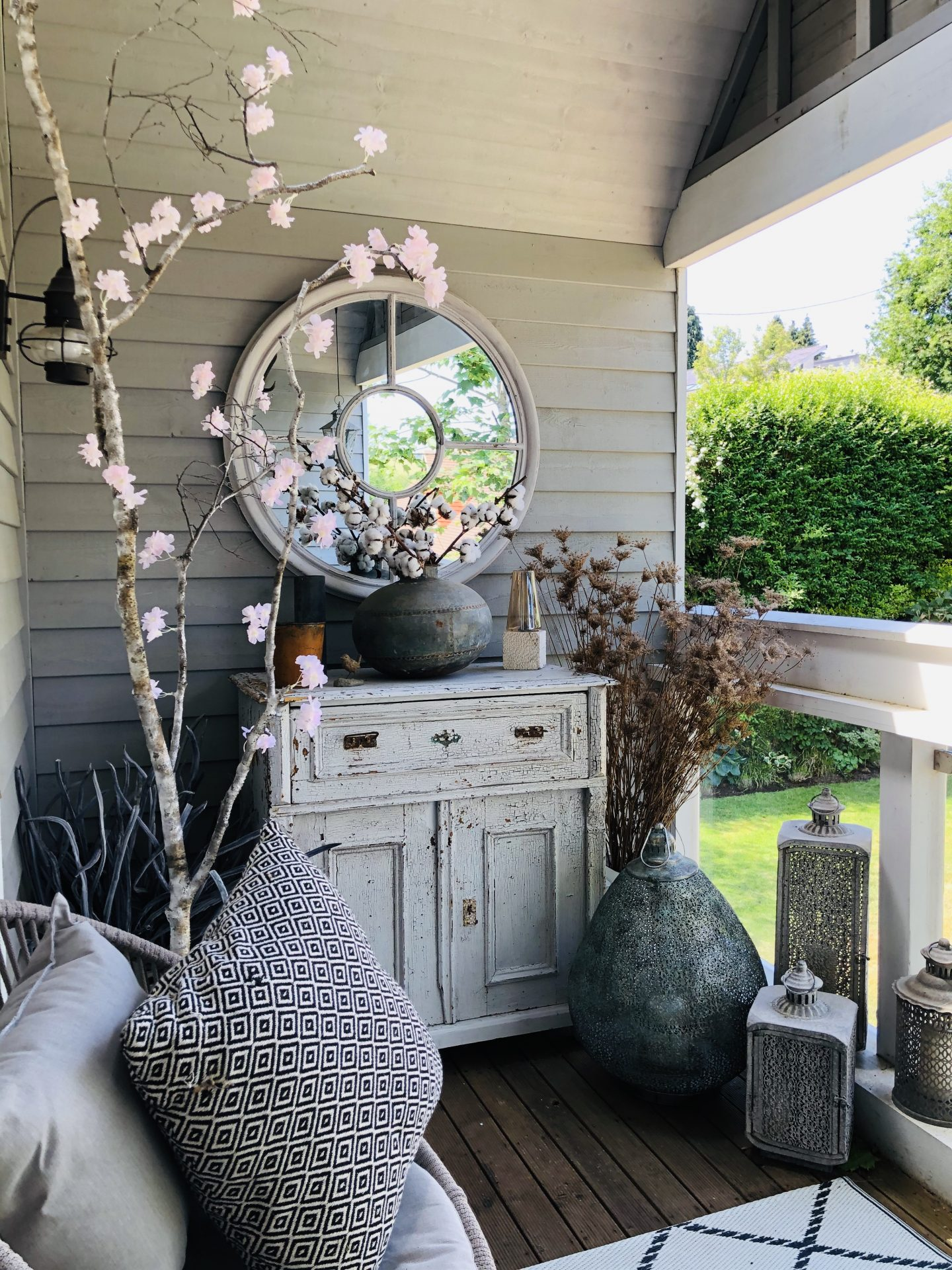 Balcony with faux cherry blossom made by Jp Clark jpslifeandloves.com