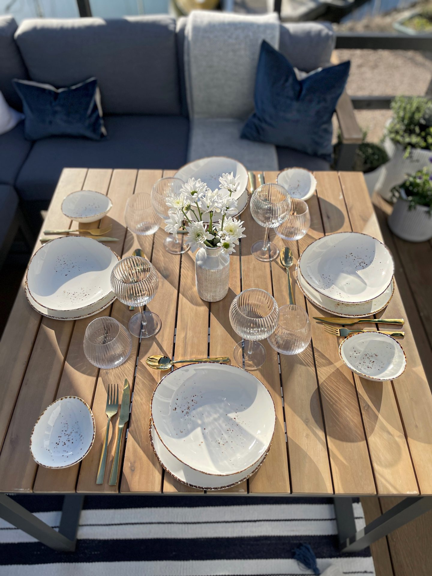 The Albany Corner Dining Set with Juni Tableware and Fluted Wine glasses and Tumblers. Finished with the Whitewashed Vase.