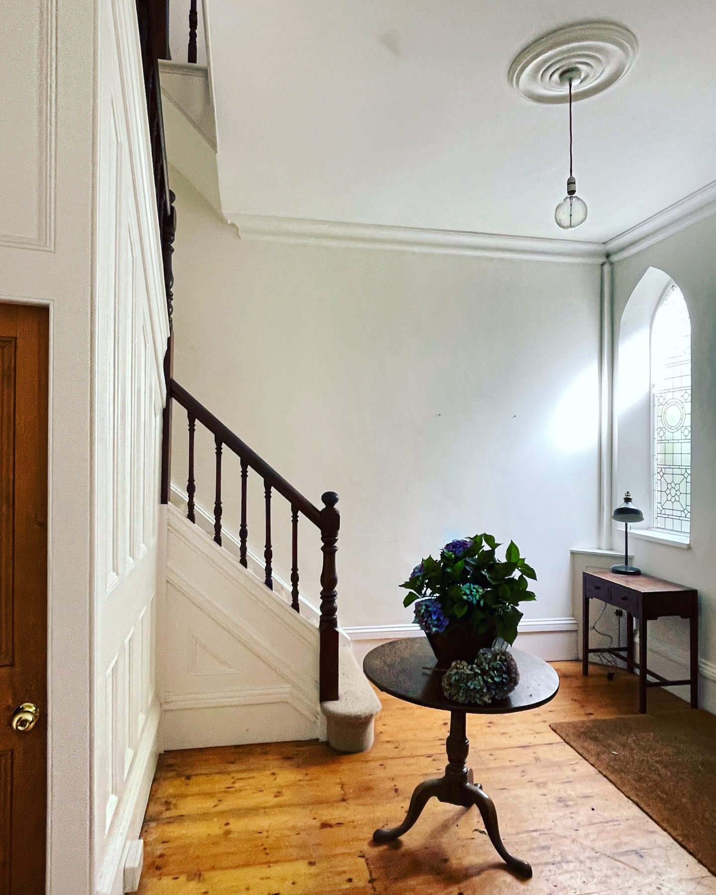 Victorian gothic semi detached house'S hallway. Arched windows